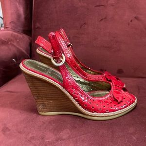 Paolo red and brown wedges with cute bow detail.